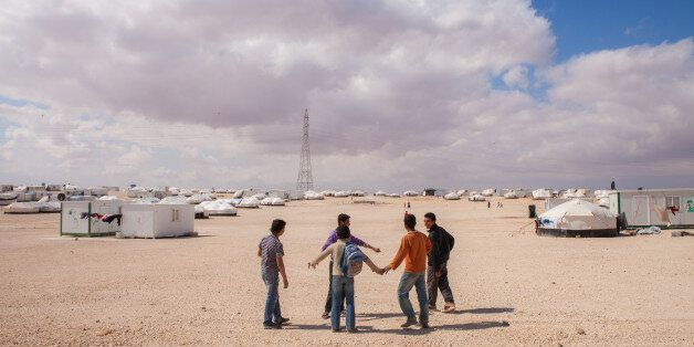 Young Syrian boys having fun at Zaatari Syrian refugee camp in northern Jordan, across the border from...