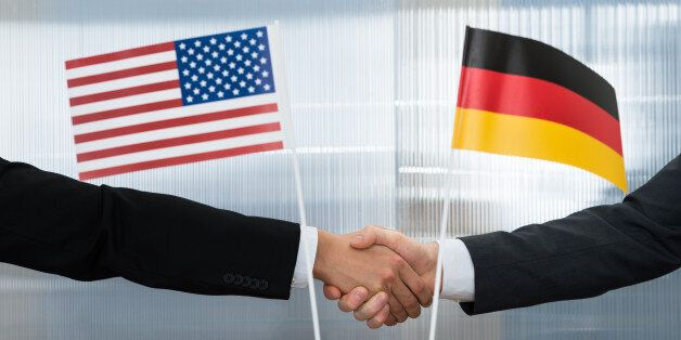 Close-up Of American And German Businessman Shaking Hands In