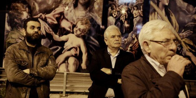Protesters in front of posters with El Greco paintings, during an anti austerity rally, in Athens, Greece...