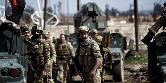 Iraqi forces gather in position as they prepare for clashes with Islamic State (IS) group fighters in...
