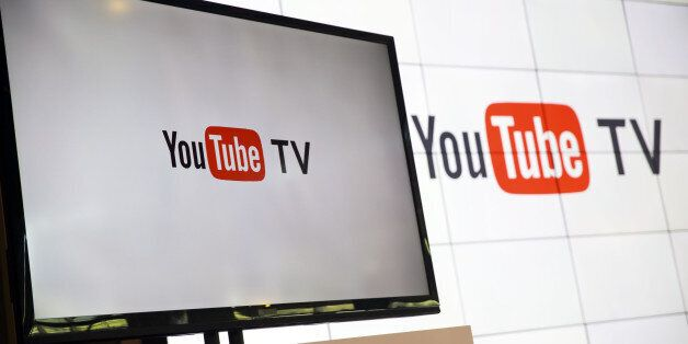 YouTube Inc. signage is displayed on a monitor after the company's new television subscription service...
