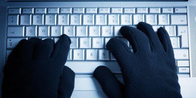 IT Crime consept Hacker works on