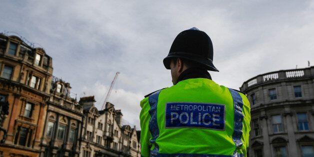 A British metropolitan police officer stands on patrol in London, U.K., on Saturday, March 4, 2017. U.K....