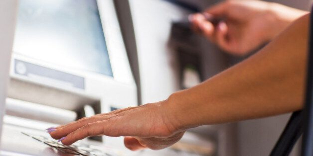 Close up of unrecognizable female person withdrawing money from