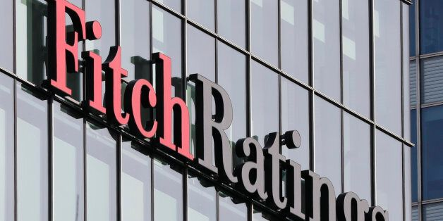 The Fitch Ratings logo is seen at their offices at Canary Wharf financial district in London,Britain,...