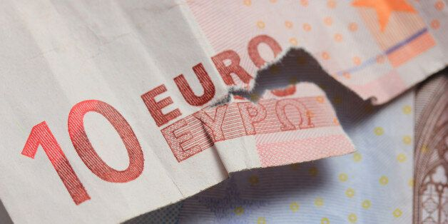 Torn euro note, almost missing the word Euro in Greek