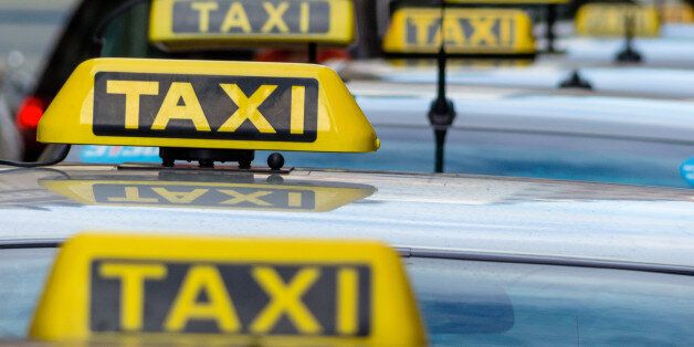 taxis wait at a taxi rank, symbolic photo for passenger transport and