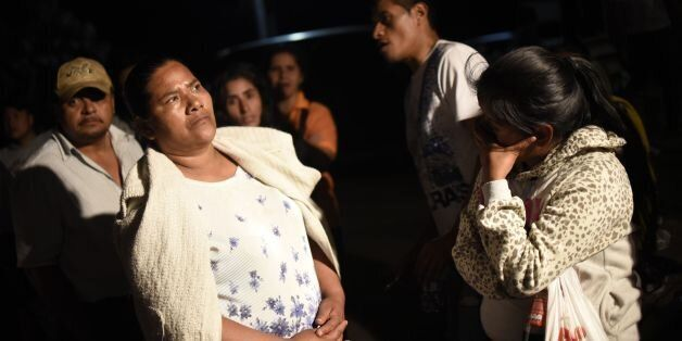 Relatives wait for information outside the children's shelter Virgen de la Asuncion after a fire at the...