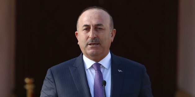 Turkey's Foreign Minister Mevlut Cavusoglu speaks to the media during a visit in Nicosia, northern Cyprus,...