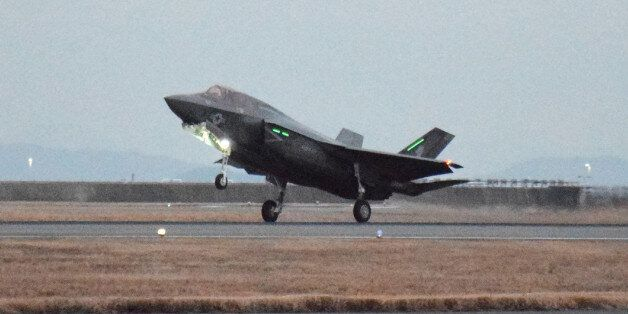 This picture taken on January 18, 2017 shows a US F-35B stealth fighter jet landing at the US Marine's...