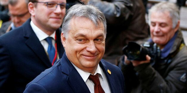 Hungary's Prime Minister Viktor Orban arrives at a European Union leaders summit in Brussels, Belgium,...
