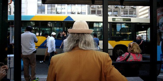 Man wearing a hat waits at the bus station, Athens, May 25, 2016 (Photo by Giorgos Georgiou/NurPhoto...