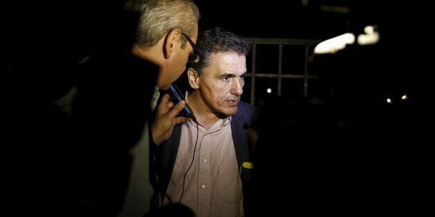 Greece's head negotiator with its lenders Euclid Tsakalotos talks to journalists outside the Maximos...