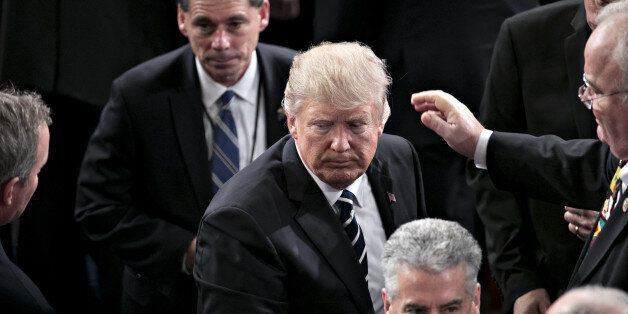 U.S. President Donald Trump exits after speaking during a joint session of Congress in Washington, D.C.,...