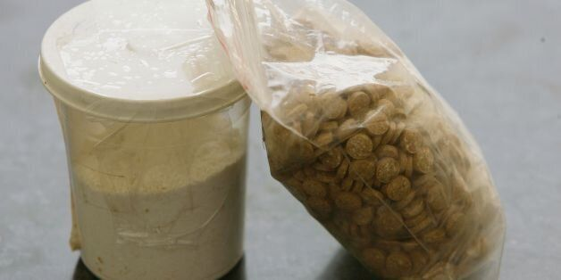 TO GO WITH AFP STORY BY MOHAMMED HARISICaptagon pills are displayed along with a cup of cocaine at an...