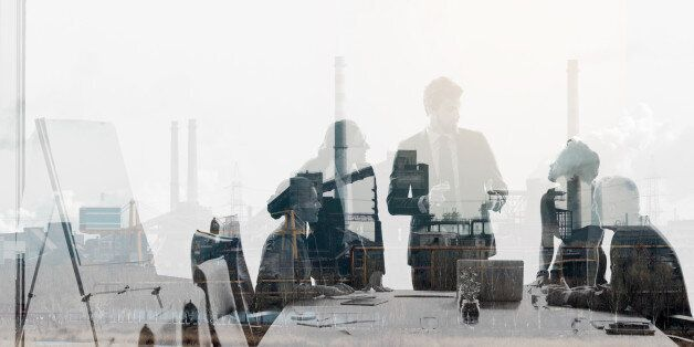Multiple exposure shot of colleagues in a meeting superimposed over an industrial