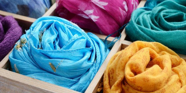 Vintage wooden box with different colorful scarves