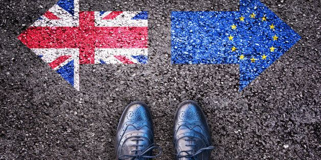Brexit, flags of the United Kingdom and the European Union on asphalt road with