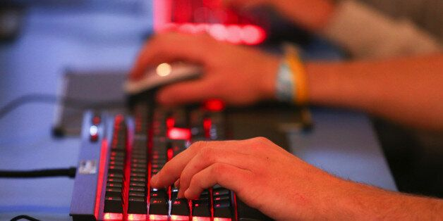 Visitos use keyboards to play computer games during the EGX gaming conference at Earls Court in London,...