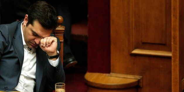Greek Prime Minister Alexis Tsipras reacts as he attends a parliamentary session in Athens, Greece July...