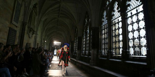 Models presents creations by Gucci at a catwalk show in the cloisters of Westminster Abbey in London,...