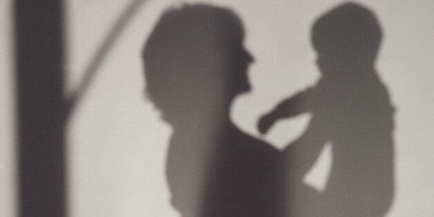 A shadow of a woman holding a
