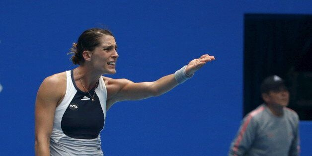 Andrea Petkovic of Germany gestures during a women's singles match against Sara Errani of Italy at the...