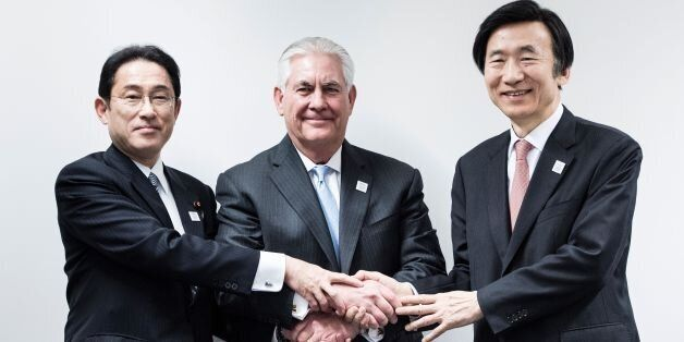 Japan's Foreign Minister Fumio Kishida (L), US Secretary of State Rex Tillerson (C) and South Korean...