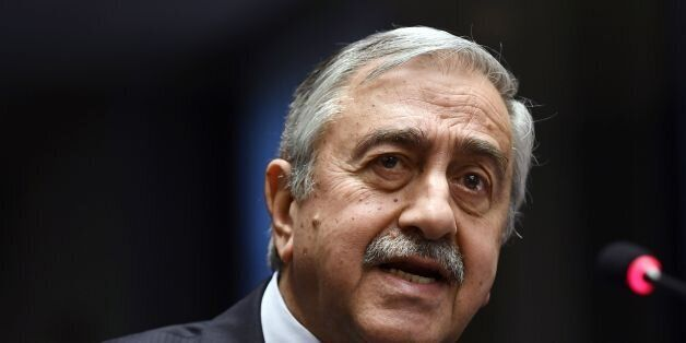 Turkish Cypriot leader Mustafa Akinci arrives for a press conference on UN-sponsored Cyprus peace talks...