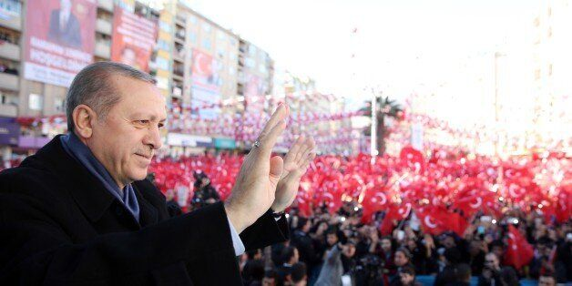 KAHRAMANMARAS, TURKEY - FEBRUARY 17: Turkish President Recep Tayyip Erdogan salutes people during an...