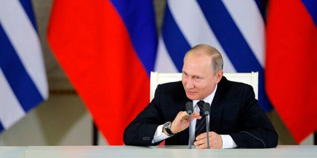 Russian President Vladimir Putin speaks after signing a bilateral agreement with his Uruguayan counterpart...