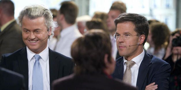Dutch extreme-right MP Geert Wilders (L)' Party for Freedom Right-wing party is flanked by VVD leader...