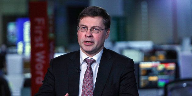 Valdis Dombrovskis, vice president of the European Commission, gestures while speaking during a Bloomberg...