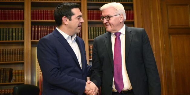 Greek prime minister Alexis Tsipras (L) welcomes German Foreign Minister Frank-Walter Steinmeier prior...