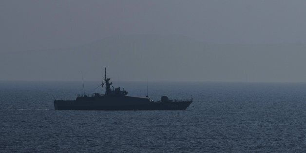 A Turkish warship and a coast guard helicopter patrol the egean sea between Turkish coast and Lesbos...