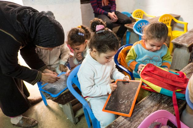 A Koran classroom setting for younger children in the old city of Fes, Morocco. (Photo by David Bathgate/Corbis...