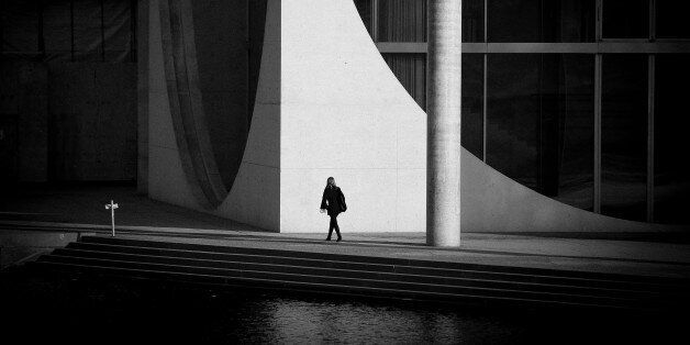 A woman is seen walking past a government building near the Reichstag on 13 February, 2017. (Photo by...