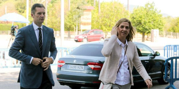 Spain's Princess Cristina arrives at court with her husband Inaki Urdangarin to attend trial in Palma...