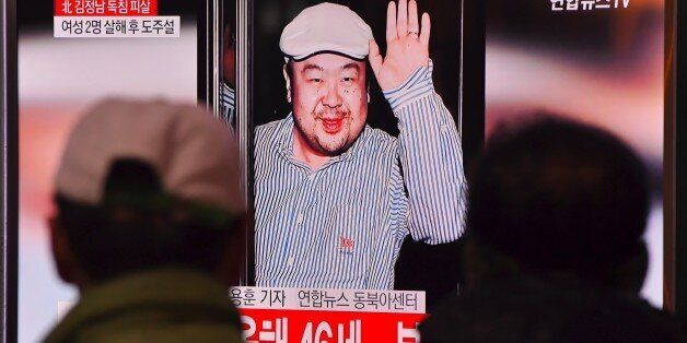People watch a television showing news reports of Kim Jong-Nam, the half-brother of North Korean leader...