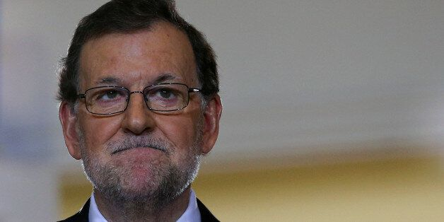 Spanish Prime Minister Mariano Rajoy reacts as he gives a year-end news conference at Moncloa palace...