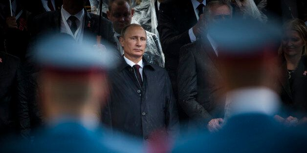 Belgrade, Serbia - October 16, 2014: Russian President seen through the soldiers during the military...