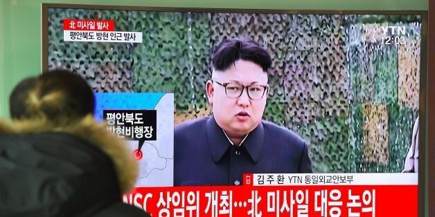 A man watches the news showing file footage of North Korean leader Kim Jong-Un at a railway station in...