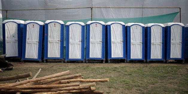 Temporary lavatories are seen at the venue of World Culture Festival on the banks of the river Yamuna...