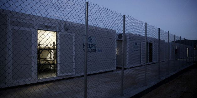 Containers to house migrants and refugees are placed in line at the migrant registration centre on the...
