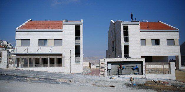 JERUSALEM - DECEMBER 29: Israeli settlements, under construction are seen, in Palestinian lands in Jerusalem,...