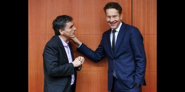 Greek Finance Minister Euclid Tsakalotos (L) chats with Dutch Finance Minister and Eurogroup President...