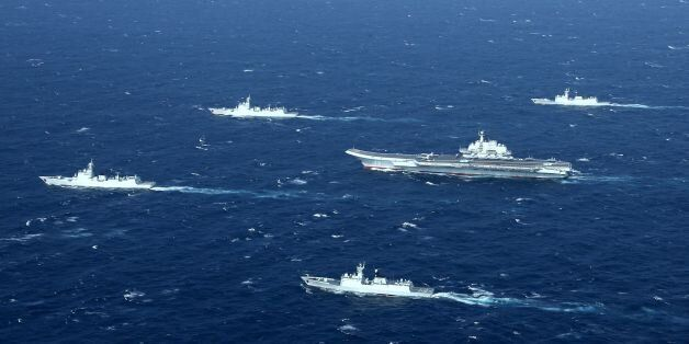 This aerial photo taken on January 2, 2017 shows a Chinese navy formation, including the aircraft carrier...