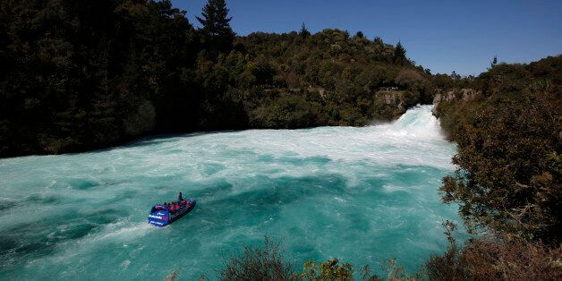 Visitors on a jet boat take in the sights of Taupo's Huka Falls on the Waikato river September 28, 2011....