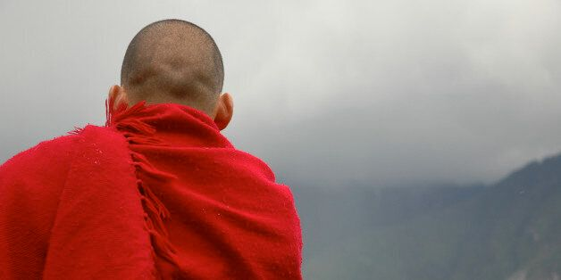 A monk meditates on a mountain in