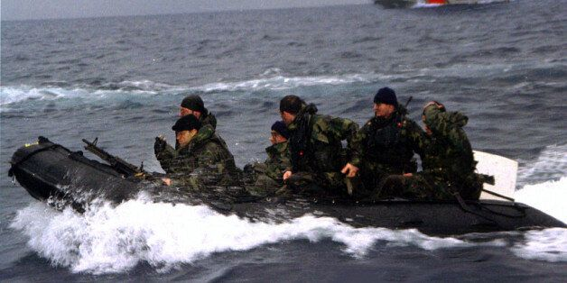 Turkish commandos return after landing on the disputed island of Imia/Kardak after Greece withdrew from...